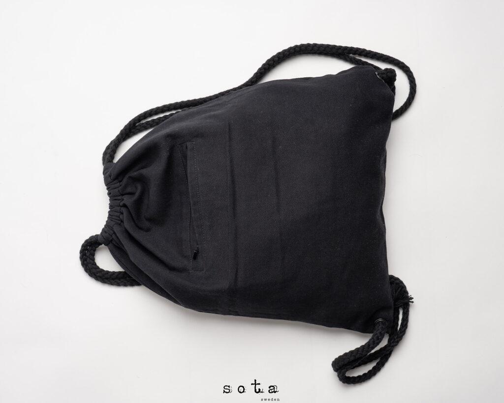 Foto av svart ryggsäck